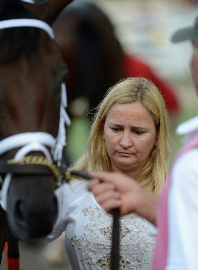 Trainer Kathy Ritvo saddles one of her horses in the 10 race at the Saratoga Race Course in Saratoga Springs, N.Y. Aug. 27, 2012.    (Skip Dickstein/Times Union) Photo: Skip Dickstein