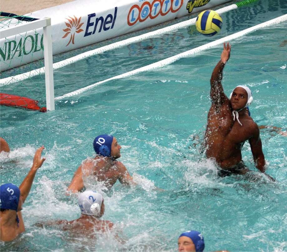 Greenwich Water Polo has named Nathaniel Miller as its new head coach and program director. Above, Miller, who has played professionally in Brazil, Spain, France & Montenegro, rises high out of the water to grab the ball as a member of the Canadian National team. Photo: Contributed Photo