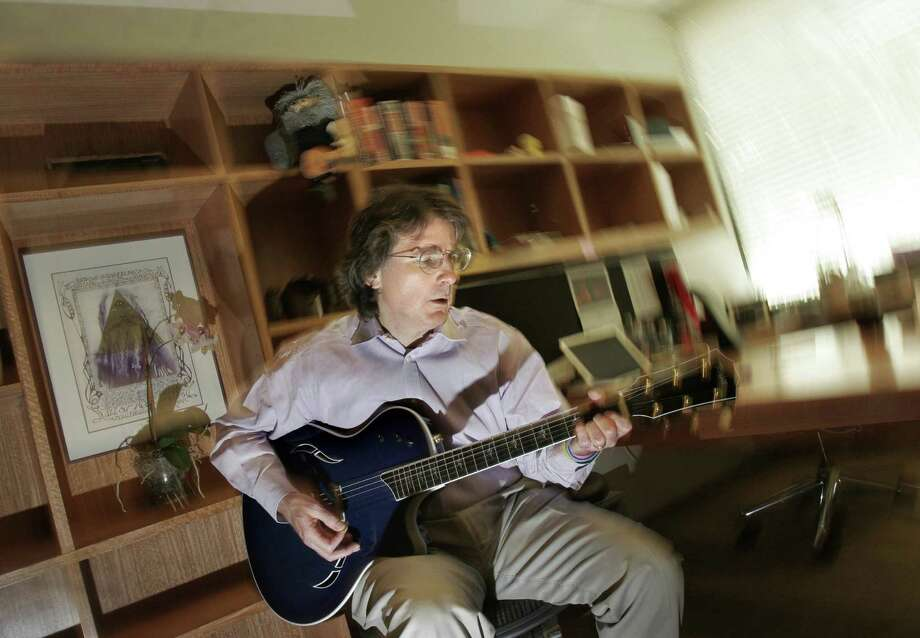 KRT BUSINESS STORY SLUGGED: CPT-NETWORKER KRT PHOTOGRAPH BY JOANNE HO-YOUNG LEE/SAN JOSE MERCURY NEWS (August 31) Roger McNamee plays his electric guitar inside his office at Elevation Partners in Menlo Park, California, on June 17, 2005. He's made some news recently when he teamed up with U2's lead vocalist, Bono, to form a new investment firm called Elevation Partners. (cdm) 2005 Photo: JOANNE HO-YOUNG LEE / SAN JOSE MERCURY NEWS