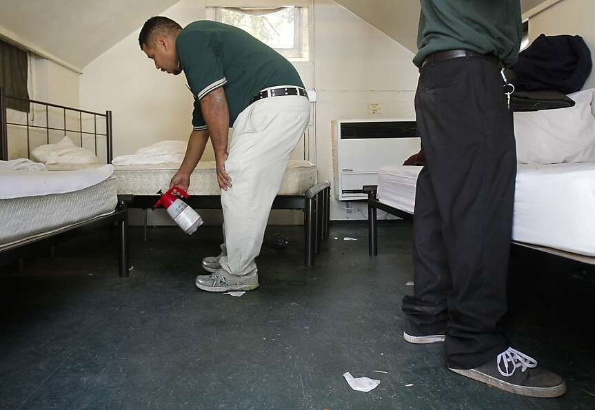 Housekeeper, Albert Gomez, on Tuesday August 28, 2012,  sprays the floors of a  tent cabin with a bl