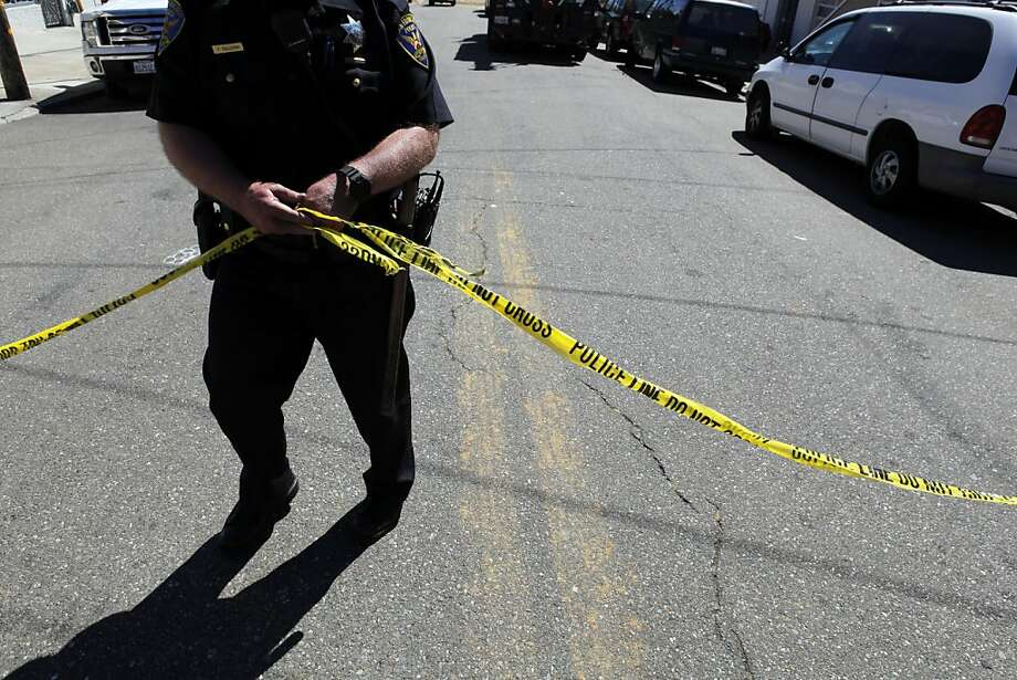 San Francisco Police Officer Sullivan puts of police tape blocking a street from access after a water main ruptured at the intersection of Sunnydale Avenue and Cora Street in San Francisco, Calif., on Tuesday, August 28, 2012. Photo: Carlos Avila Gonzalez, The Chronicle