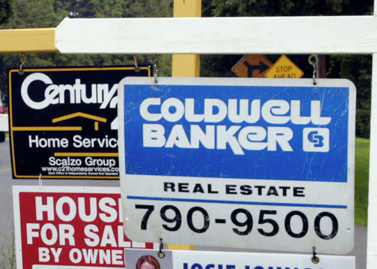 File photo : Real Estate for sale signs on a traffic triangle on Coal Pit Hill Rd in Danbury on the border of Bethel.