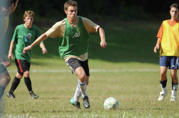 Chris Schmid moves the ball up the field  during Shenendehowa High School boy's varsity soccer practice on Monday, Aug. 27, 2012 in Clifton Park, NY.  (Paul Buckowski / Times Union) Photo: Paul Buckowski