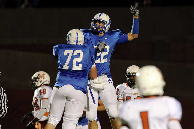 MacArthur's Jace Amaro (22) celebrates his 60-yard plus touchdown reception with David Roe (72) during their game against Madison in 26-5A football at Heroes Stadium on Friday, Nov. 5, 2010. Kin Man Hui/kmhui@express-news.net Photo: KIN MAN HUI, Express-News / kmhui@express-news.net