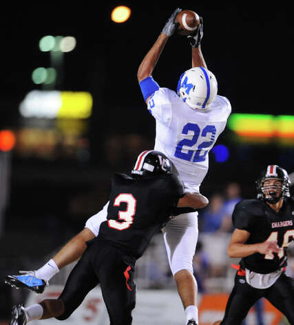 MacArthur's Jace Amaro (22) leaps high in the air to make a reception during a district 26-5A football game between the MacArthur Brahmas and the Churchill Chargers at Comalander Stadium in San Antonio, Texas on October 8, 2010 