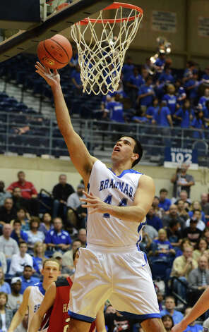 San Antonio MacArthur's Jace Amaro (44) hits a lay-up on a fast break during the 5A boys regional semifinal basketball game between the San Antonio MacArthur Brahmas and the Harlingen Cardinals in the UTSA Convocation Center in San Antonio, Texas on March 4, 2011 