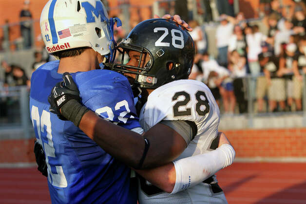 SPORTS Steele's star running back Malcolm Brown is congratulated by Mac receiver Jace Amaro after MacArthur loses to Steele at Heroes Stadium in fourth round 5A playoffs on Saturday Dec. 4, 2010. Tom Reel/Staff Photo: TOM REEL, Express-News / © 2010 San Antonio Express-News