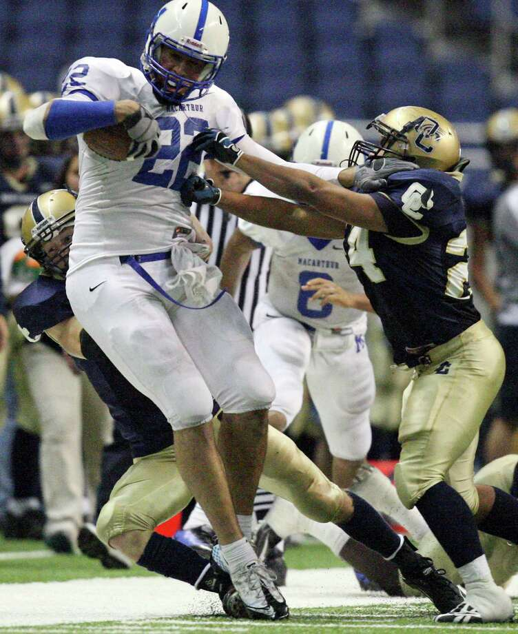 FOR SPORTS - MacArthur's Jace Amaro tries to shake the tackle of O'Connor's Jeff Cirrotto (rear) and teammate O'Connor's Matt Ramon during second half action Saturday Nov. 20, 2010 at the Alamodome. MacArthur won 52-28. Photo: EDWARD A. ORNELAS, Express-News / eaornelas@express-news.net