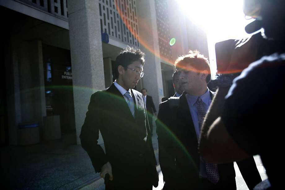 Japanese Vice Consul Yoshiaki Nagaya (left) exits a hearing at San Mateo County Superior Court in Redwood City. Photo: Lea Suzuki, The Chronicle