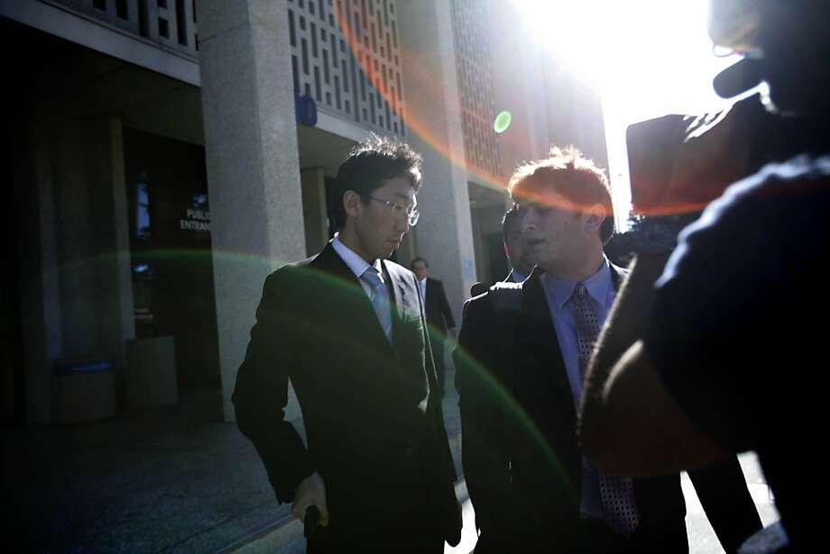 Japanese Vice Consul Yoshiaki Nagaya (left) exits a hearing at San Mateo County Superior Court in Redwood City. Photo: Lea Suzuki, The Chronicle