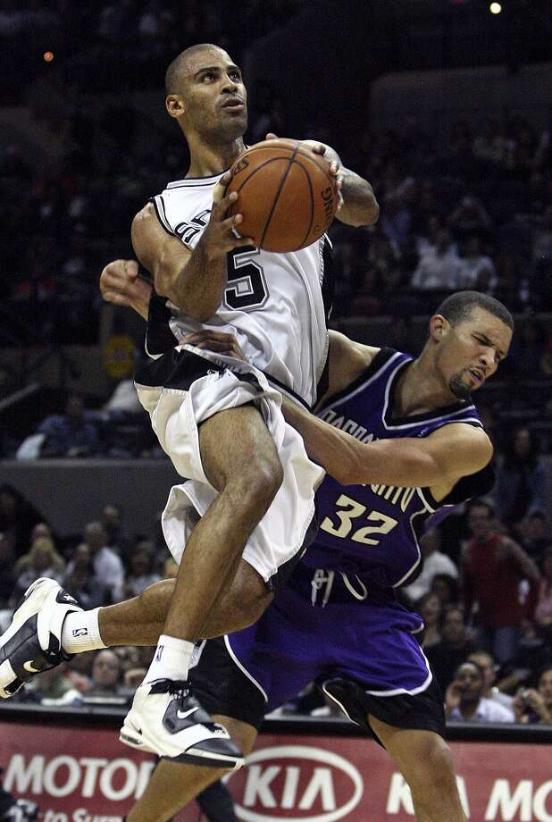 The Spurs new guard Ime Udoka drives to the bucket despite being held down by the Kings' Francisco Garcia in the second half Friday night at the AT&T Center. (TOM REEL / SAN ANTONIO EXPRESS-NEWS)