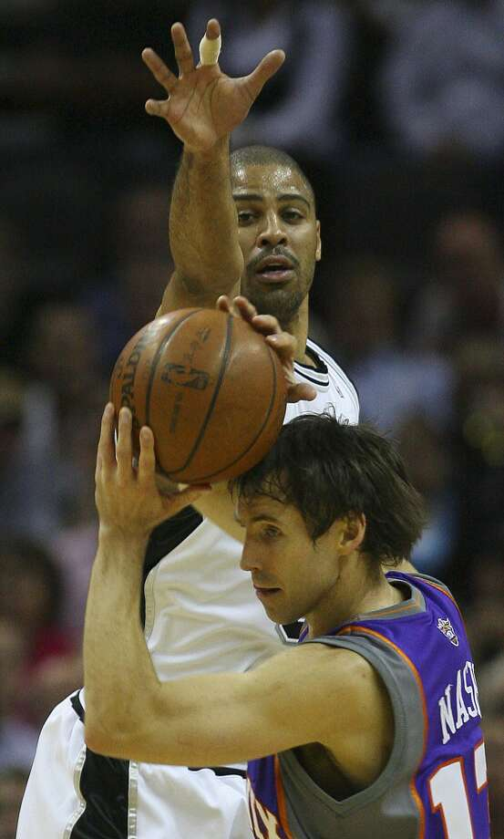 Ime Udoka defends Steve Nash in the first half of game five in their first-round series Tuesday, April 29, 2008 at the AT&T Center.  (BAHRAM MARK SOBHANI / SAN ANTONIO EXPRESS NEWS)