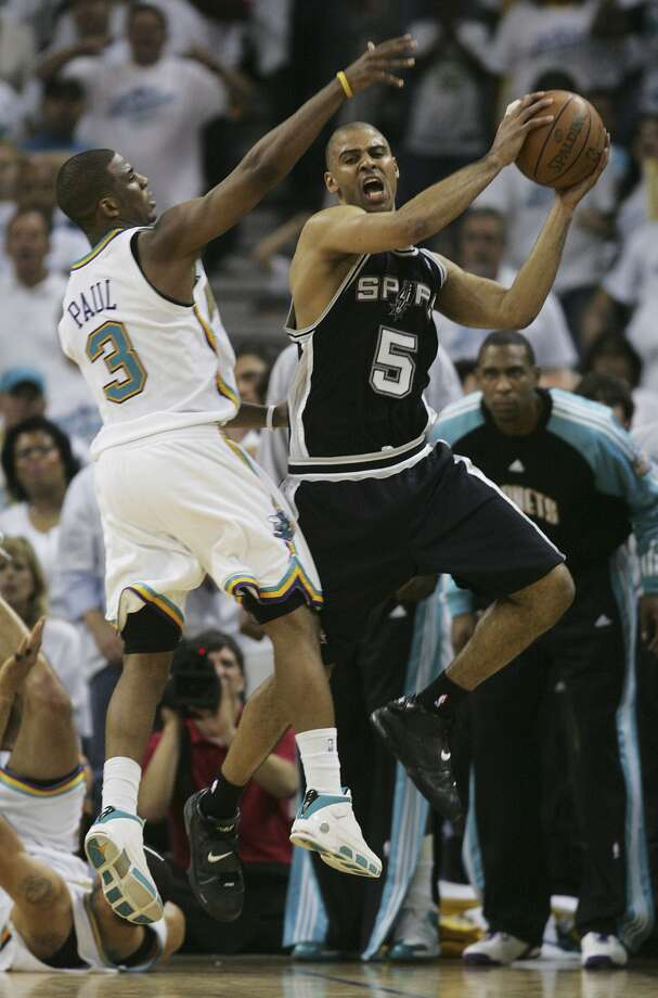 Ime Udoka gets an offensive rebound in front of Chris Paul in the second half in game seven of their Western Conference semifinals game Monday, May 19, 2008 at New Orleans Areana. The Spurs won 91-82 to advance to the Conference Finals.  (BAHRAM MARK SOBHANI / SAN ANTONIO EXPRESS NEWS)