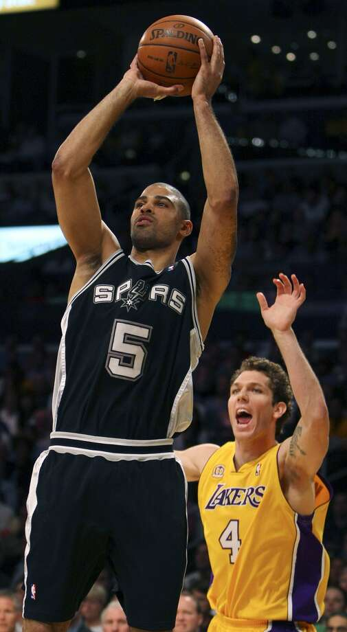 Spurs' Ime Udoka shoots around Lakers' Luke Walton during first half action of game 1 in the NBA Western Conference Finals Wednesday May 21, 2008 at the Staples Center in Los Angeles, CA.  (EDWARD A. ORNELAS / SAN ANTONIO EXPRESS-NEWS)