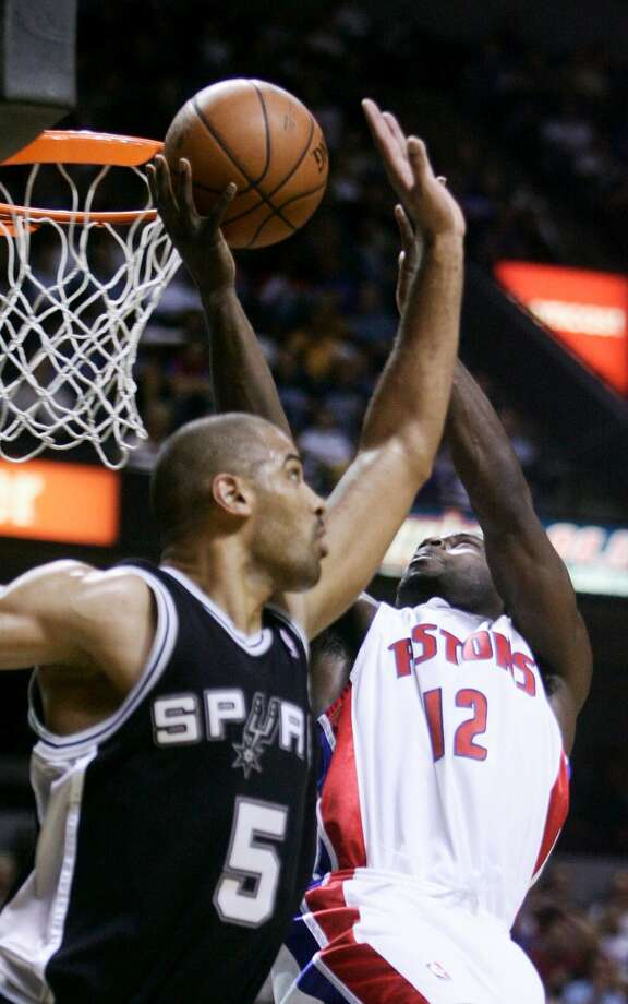 Detroit Pistons guard Will Bynum (12) goes for the layup past San Antonio Spurs guard Ime Udoka in the fourth quarter of an NBA exhibition basketball game in Grand Rapids, Mi., Tuesday, Oct. 14, 2008. The Spurs won 86-65.  (Adam Bird / AP)
