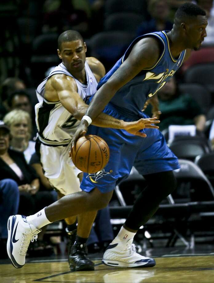 Ime Udoka defends Andray Blatche in the first half of their preseason game Wednesday, October 22, 2008 at the AT&T Center. (BAHRAM MARK SOBHANI / SAN ANTONIO EXPRESS NEWS)