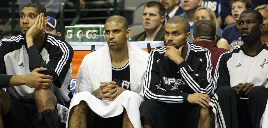 FOR SPORTS - Spurs' Tim Duncan (from left) Ime Udoka Tony Parker and Michael Finley sit dejected on the bench near the end of Game 3 in the First Round of the Western Conference Playoffs against the Mavericks during second half action of Thursday April 23, 2009 at the American Airlines Center in Dallas, Tx. The Mavericks won 88-67. (PHOTO BY EDWARD A. ORNELAS/eaornelas@express-news.net) (SAN ANTONIO EXPRESS-NEWS)