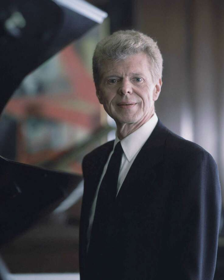 Pianist Van Cliburn poses for a portrait at the Steinway & Sons showroom in New York on March 18, 1994.   Renowned classical pianist Van Cliburn has been diagnosed with advanced bone cancer and is resting comfortably at his Texas home, his publicist said Monday Aug. 27, 2012.     (AP Photo/Wyatt Counts, file) NO SALES Photo: Wyatt Counts / AP