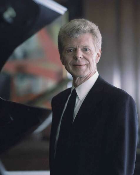 Pianist Van Cliburn poses for a portrait at the Steinway & Sons showroom in New York on March 18, 19