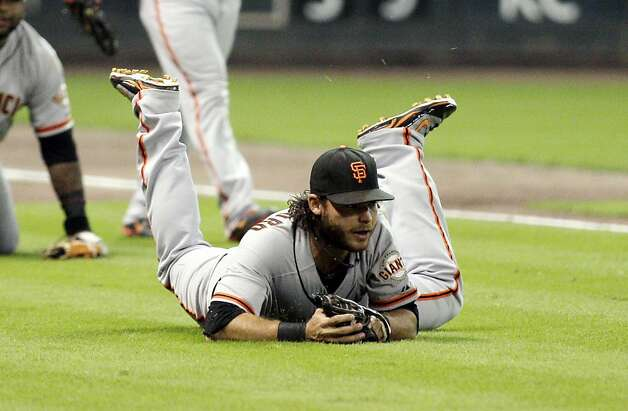 HOUSTON, TX - AUGUST 28: Shortstop Brandon Crawford #35 of the San Francisco Giants makes a diving catch after third baseman Pablo Sandoval #48 of the San Francisco Giants had the ball pop out of his  glove against the Houston Astros at Minute Maid Park on August 28, 2012 in Houston, Texas.   (Photo by Bob Levey/Getty Images) Photo: Bob Levey, Getty Images