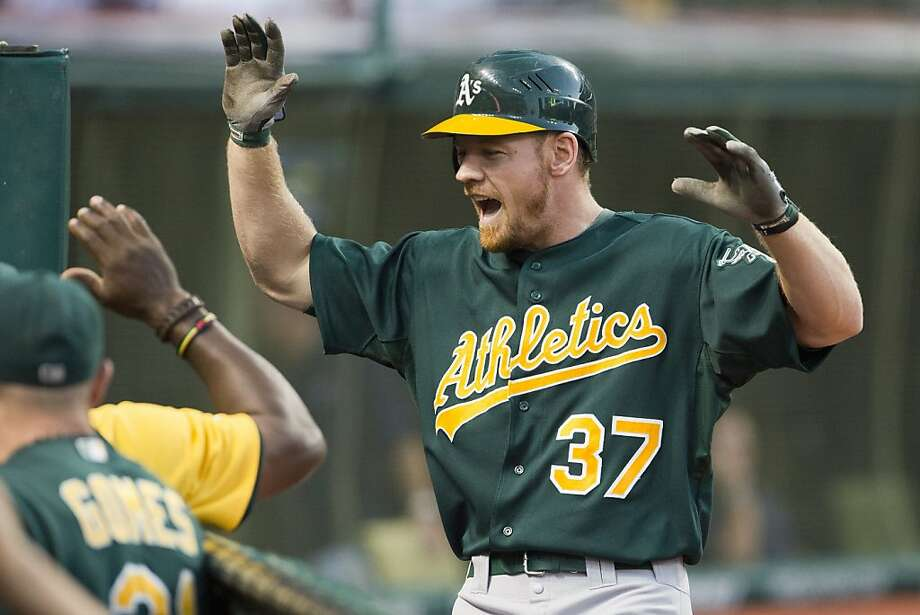 CLEVELAND, OH - AUGUST 28: Brandon Moss #37 of the Oakland Athletics celebrates after hiting a two run home run during the second inning against the Cleveland Indians at Progressive Field on August 28, 2012 in Cleveland, Ohio. (Photo by Jason Miller/Getty Images) Photo: Jason Miller, Getty Images
