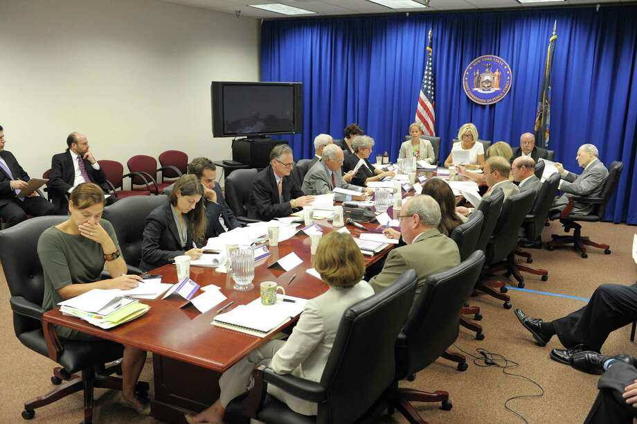 Members of the New York State Joint Commission on Public Ethics take part in a meeting on Tuesday, Aug. 28, 2012 in Albany, NY. (Paul Buckowski / Times Union) Photo: Paul Buckowski