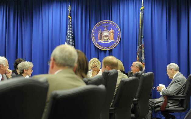 Janet DiFiore, background center, chair of the New York State Joint Commission on Public Ethics and the Westchester County District Attorney along with other members of the commission, take part in a meeting on Tuesday, Aug. 28, 2012 in Albany, NY. (Paul Buckowski / Times Union) Photo: Paul Buckowski