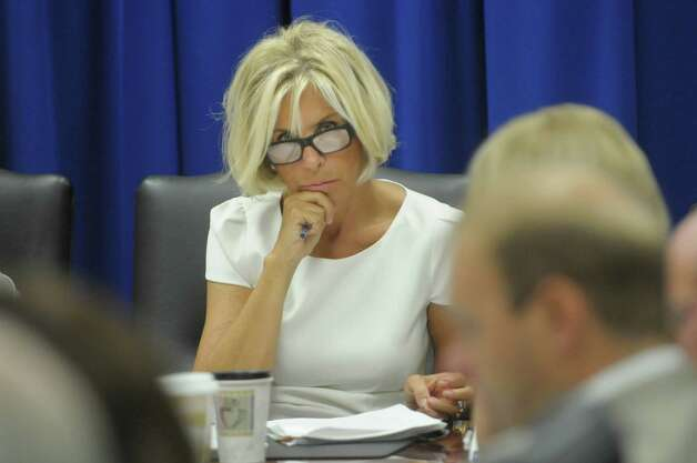 Janet DiFiore, chair of the New York State Joint Commission on Public Ethics and the Westchester County District Attorney along with other members of the commission, take part in a meeting on Tuesday, Aug. 28, 2012 in Albany, NY. (Paul Buckowski / Times Union) Photo: Paul Buckowski