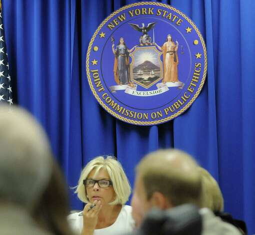 Janet DiFiore, background, chair of the New York State Joint Commission on Public Ethics and the Westchester County District Attorney along with other members of the commission, take part in a meeting on Tuesday, Aug. 28, 2012 in Albany, NY. (Paul Buckowski / Times Union) Photo: Paul Buckowski