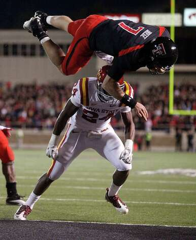 Texas Tech's Seth Doege (7) dives for a touchdown over Iowa State's Durrell Givens (24) during an NCAA college football game, in Lubbock, Texas, Saturday, Oct. 29, 2011.  (AP Photo/Lubbock Avalanche-Journal, Stephen Spillman) Photo: Stephen Spillman, Associated Press / AP