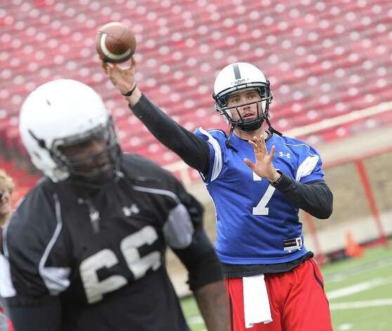 Texas Tech quarterback Seth Doege throws a pass over lineman Deveric Gallington during spring NCAA college football practice at Jones AT&T Stadium in Lubbock, Texas, Saturday, Feb. 18, 2012. (AP Photo/Lubbock Avalanche-Journal, Zach Long) ALL LOCAL TV OUT Photo: Zach Long, Associated Press / Lubbock Avalanche-Journal
