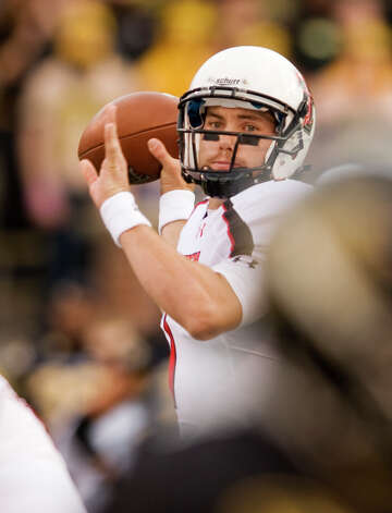 Texas Tech quarterback Seth Doege throws a pass during the first quarter of an NCAA college football game against Missouri Saturday, Nov. 19, 2011, in Columbia, Mo. Missouri won the game 31-27. Doege threw for one touchdown and ran for another for Texas Tech (5-6, 2-6), which has lost four in a row and must beat Baylor next week to become bowl eligible for the 12th straight season. (AP Photo/L.G. Patterson) Photo: L.G. PATTERSON, Associated Press / FR23535 AP