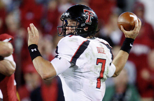 Texas Tech quarterback Seth Doege passes against Oklahoma in the fourth quarter of an NCAA college football game in Norman, Okla., Saturday, Oct. 22, 2011. Texas Tech won 41-38. (AP Photo/Sue Ogrocki) Photo: Sue Ogrocki, Associated Press / AP