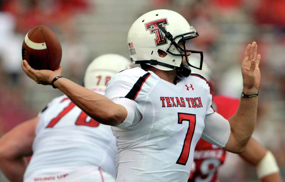 Texas Tech quarterback Seth Doege winds up a pass against New Mexico during their NCAA college football game, Saturday, Sept. 17, 2011, in Albuquerque, N.M. The games was delayed twice due to lightning. Texas Tech defeated New Mexico 59-13. (AP Photo/Albuquerque Journal, Roberto E. Rosales) Photo: Roberto E. Rosales, Associated Press / Albuquerque Journal