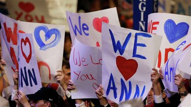 Supporters hold up signs as Ann Romney, wife of U.S. Republican presidential nominee Mitt Romney, addresses the Republican National Convention in Tampa, Fla., on Tuesday, Aug. 28, 2012. (AP Photo/Charlie Neibergall)