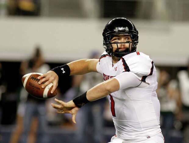 FILE - In this Nov. 26, 2011, file photo, Texas Tech quarterback Seth Doege throws a pass in the first half of an NCAA college football game in Arlington, Texas. Doege says he's ready to show fans the Red Raiders are back. Texas Tech opens its season at home on Sept. 1 against Northwestern State. (AP Photo/Sharon Ellman, File0 Photo: Sharon Ellman, Associated Press / FR170032 AP