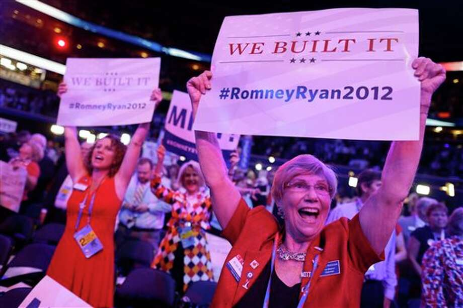 Georgia delegates Ruby Robinson, right, and Kathy Noble, left, hold up signs and cheer during the Republican National Convention in Tampa, Fla., on Tuesday, Aug. 28, 2012. (AP Photo/Charles Dharapak) (AP)