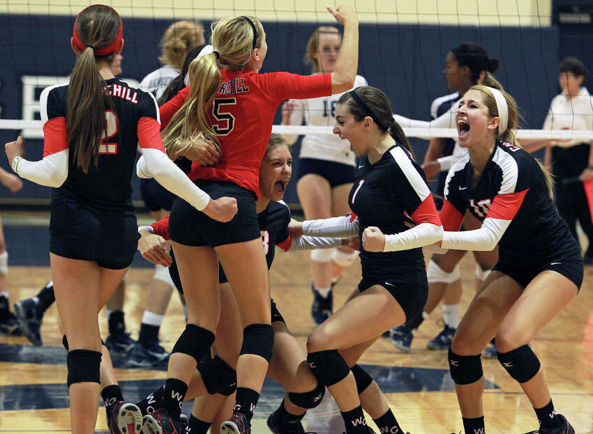 The Chargers celebrate a kill as Churchill beats Smithson Valley 3-0 at Smithson Valley gym on August 28, 2012.