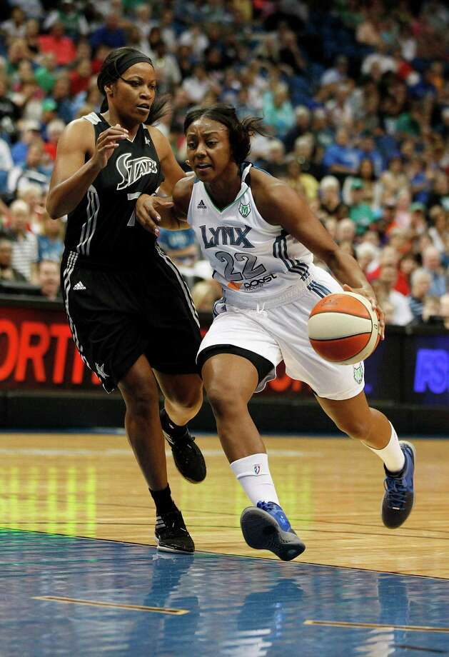 Minnesota Lynx guard Monica Wright (22) drives through San Antontio Silver Stars guard Jia Perkins (7) in the first half of a WNBA basketball game, Tuesday, Aug. 28, 2012, in Minneapolis. AP Photo/Stacy Bengs) Photo: Stacy Bengs, Associated Press / FR170489 AP
