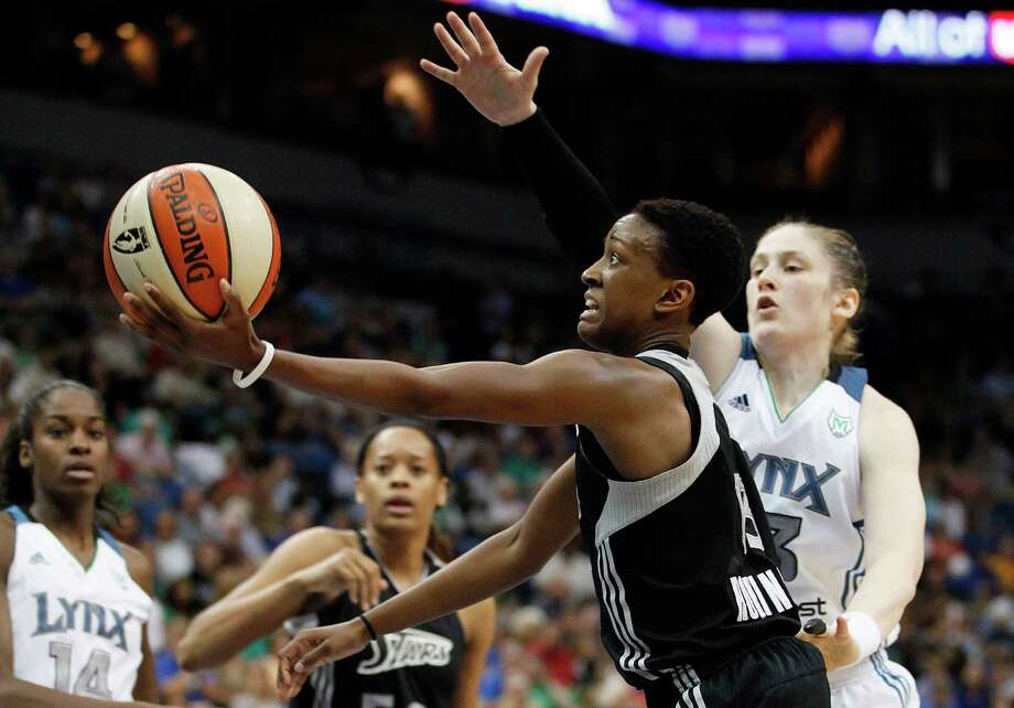 San Antonio Silver Stars guard Danielle Robinson (13) goes up for shot against Minnesota Lynx guard Lindsay Whalen (13) in the second half of a WNBA basketball game, Tuesday, Aug. 28, 2012, in Minneapolis. The Lynx won in overtime 96-84. AP Photo/Stacy Bengs) Photo: Stacy Bengs, Associated Press / FR170489 AP