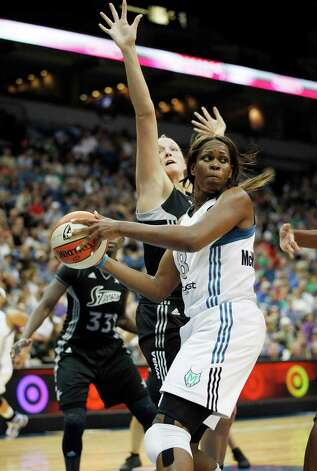 Minnesota Lynx forward Taj McWilliams-Franklin (8) look behind her back to make a pass against San Antonio Silver Stars center Jayne Appel (32) in the first half of a WNBA basketball game, Tuesday, Aug. 28, 2012, in Minneapolis. AP Photo/Stacy Bengs) Photo: Stacy Bengs, Associated Press / FR170489 AP