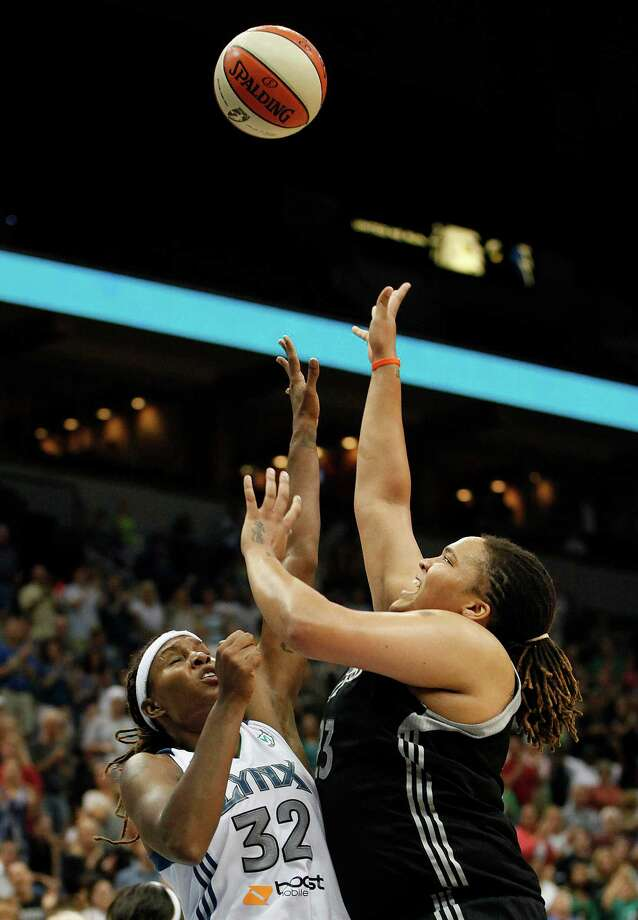 Minnesota Lynx forward Rebekkah Brunson (32) blocks the shot of San Antonio Silver Stars forward Danielle Adams (23) in the second half of a WNBA basketball game, Tuesday, Aug. 28, 2012, in Minneapolis. The Lynx won in overtime 96-84. AP Photo/Stacy Bengs Photo: Stacy Bengs, Associated Press / FR170489 AP