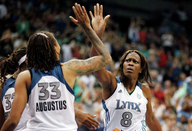 Minnesota Lynx forward Taj McWilliams-Franklin (8) high fives guard Seimone Augustus (33) in the second half of a WNBA basketball game against the San Antonio Silver Stars, Tuesday, Aug. 28, 2012, in Minneapolis. The Lynx won in overtime 96-84. AP Photo/Stacy Bengs) Photo: Stacy Bengs, Associated Press / FR170489 AP