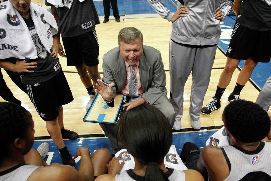 San Antontio Silver Stars head coach Dan Hughes talks with his team during a timeout against the Minnesota Lynx in the first half of a WNBA basketball game, Tuesday, Aug. 28, 2012, in Minneapolis. AP Photo/Stacy Bengs) Photo: Stacy Bengs, Associated Press / FR170489 AP