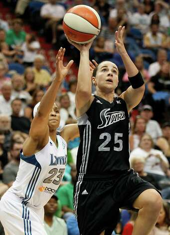 San Antonio Silver Stars guard Becky Hammon (25) goes up to the past Minnesota Lynx forward Maya Moore (23) in the second half of a WNBA basketball game, Tuesday, Aug. 28, 2012, in Minneapolis. The Lynx won in overtime 96-84. AP Photo/Stacy Bengs) Photo: Stacy Bengs, Associated Press / FR170489 AP