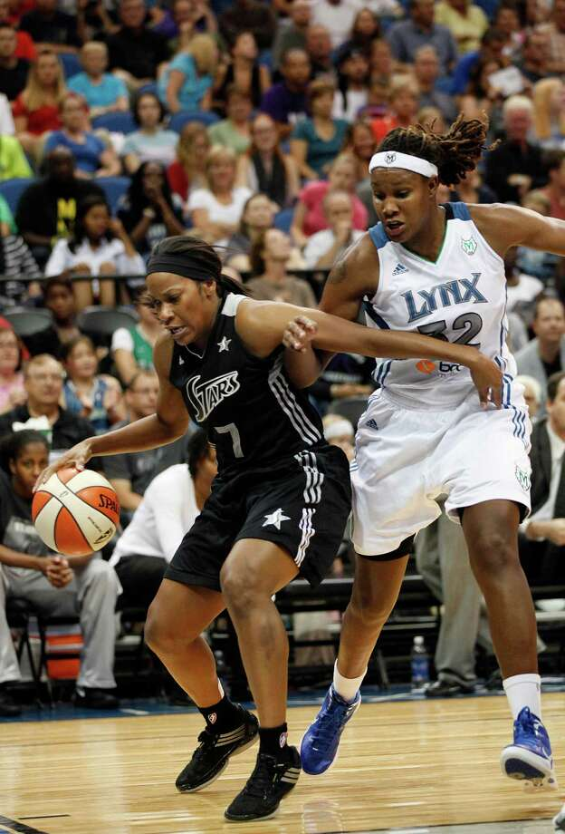 San Antonio Silver Stars guard Jia Perkins (7) tries to keep the ball in bounds against Minnesota Lynx forward Rebekkah Brunson (32) in the second half of a WNBA basketball game, Tuesday, Aug. 28, 2012, in Minneapolis. The Lynx won in overtime 96-84. AP Photo/Stacy Bengs Photo: Stacy Bengs, Associated Press / FR170489 AP