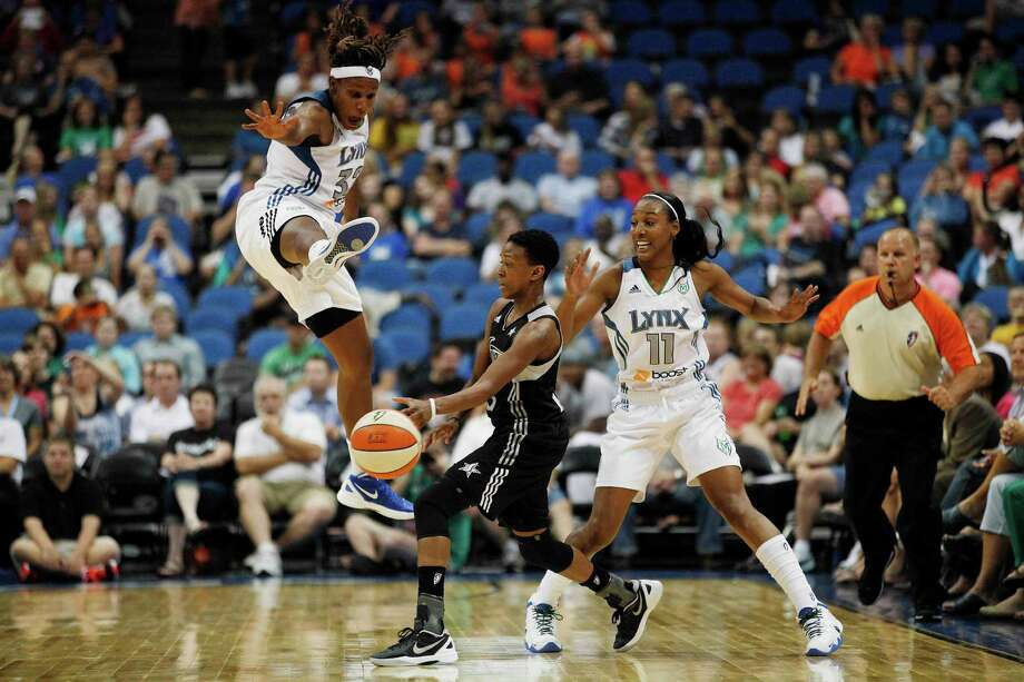 San Antonio Silver Star guard Danielle Robinson (13) makes a pass against Minnesota Lynx forward Rebekkah Brunson (32) and guard Candice Wiggins (11) in the first half of a WNBA basketball game, Tuesday, Aug. 28, 2012, in Minneapolis. AP Photo/Stacy Bengs) Photo: Stacy Bengs, Associated Press / FR170489 AP