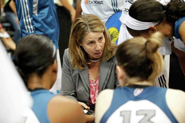Minnesota Lynx head coach Cheryl Reeve talks with her team during a timeout against the San Antonio Silver Stars in the second half of a WNBA basketball game, Tuesday, Aug. 28, 2012, in Minneapolis. The Lynx won in overtime 96-84. AP Photo/Stacy Bengs) Photo: Stacy Bengs, Associated Press / FR170489 AP