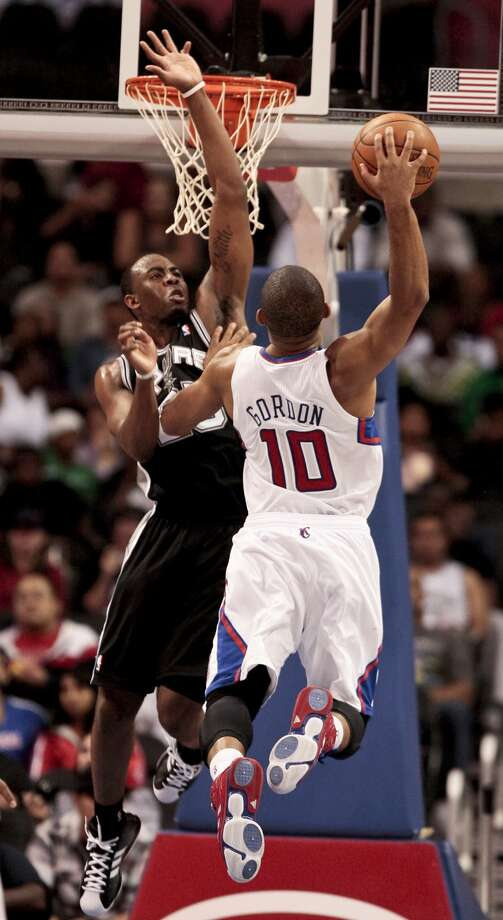 Los Angeles Clippers guard Eric Gordon, right, dunks over San Antonio Spurs guard James Anderson during the first half of an NBA basketball game Monday, Nov. 1, 2010, in Los Angeles. The Spurs won 97-88. (AP Photo/ Bret Hartman) (AP)