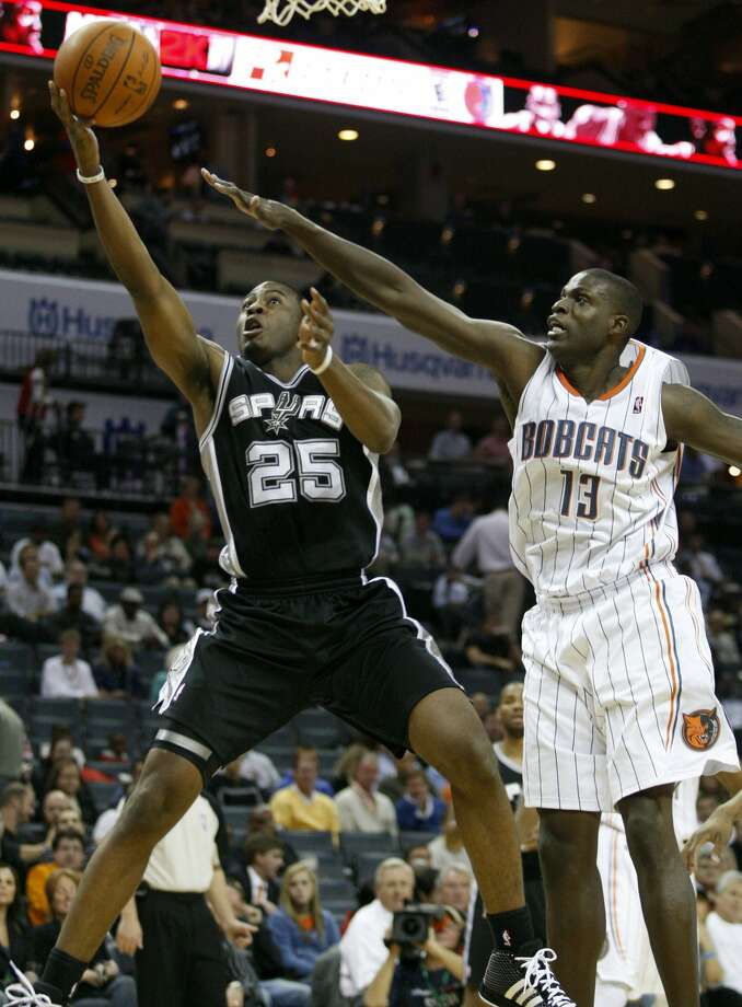 San Antonio Spurs guard James Anderson, left, drives past Charlotte Bobcats center Nazr Mohammed in the first half of an NBA basketball game Monday, Nov. 8, 2010 in Charlotte, N.C. (AP Photo/Nell Redmond) (AP)